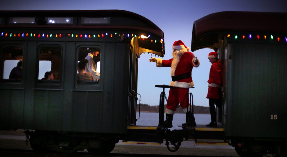 Susan E. Reed: Christmas is not only about the child of the star, but creativity in general, including the birth of ideas, which require first, an adventurous departure from the known. Pictured: Santa Claus moves between cars greeting passengers in Portland, Maine. (Robert F. Bukaty/AP)
