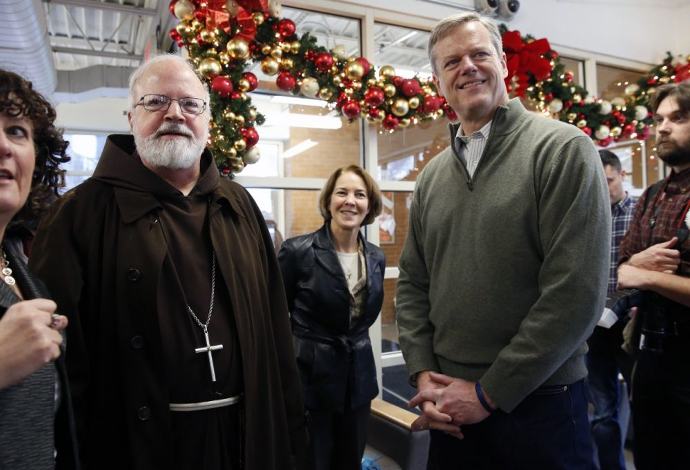 Archbishop of Boston Sean O'Malley, left, and Gov.-elect Charlie Baker stand together before serving meals at the Pine Street Inn homeless shelter in Boston on  Wednesday. (Michael Dwyer/AP)