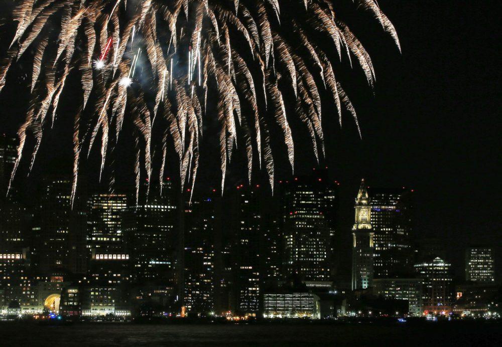 Fireworks lighting up the sky over Boston Harbor celebrating First Night in Boston, Jan. 1, 2014. (Elise Amendola/AP File)