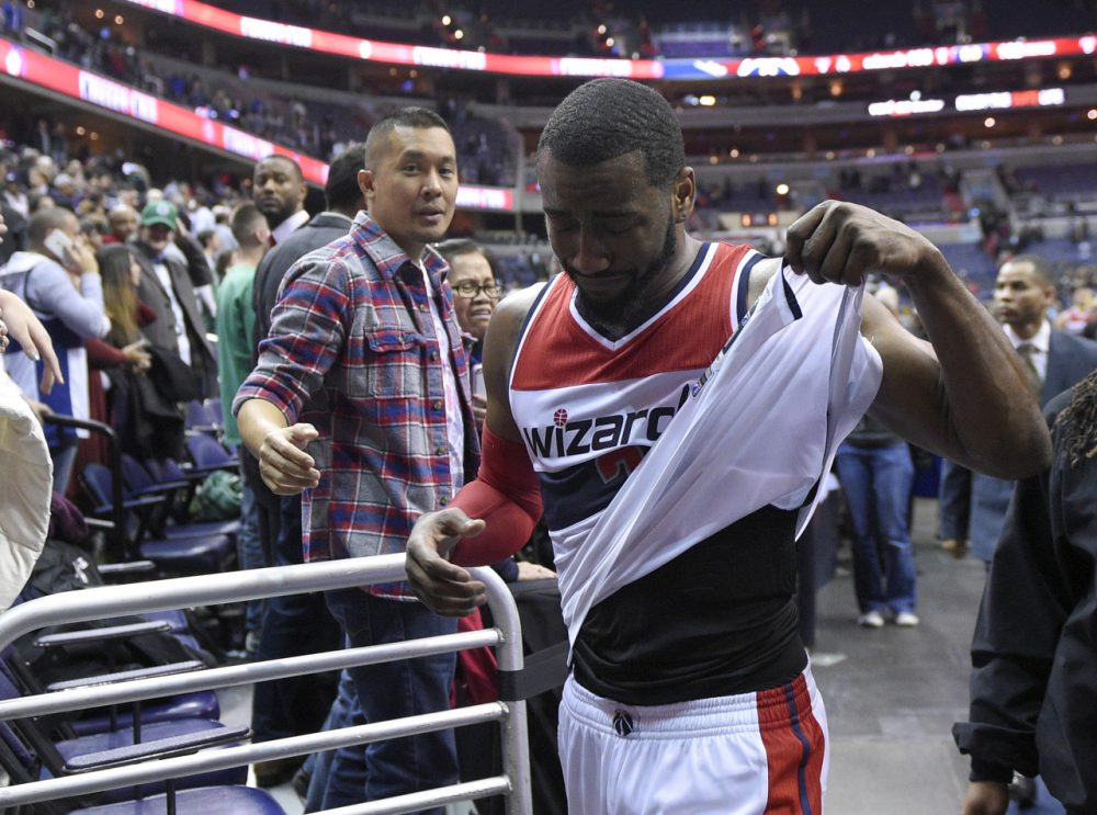 Washington Wizards guard John Wall (2) reacts after an NBA basketball game against the Boston Celtics, Monday, Dec. 8, 2014, in Washington. The Wizards won 133-132 in double overtime. (Nick Wass/AP)