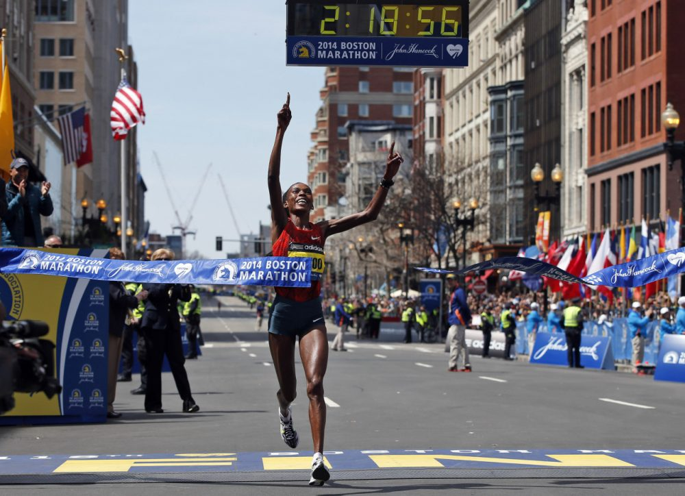 Rita Jeptoo, of Kenya, breaks the tape to win the women's division of the 118th Boston Marathon Monday, April 21, 2014 in Boston. (AP Photo/Elise Amendola)