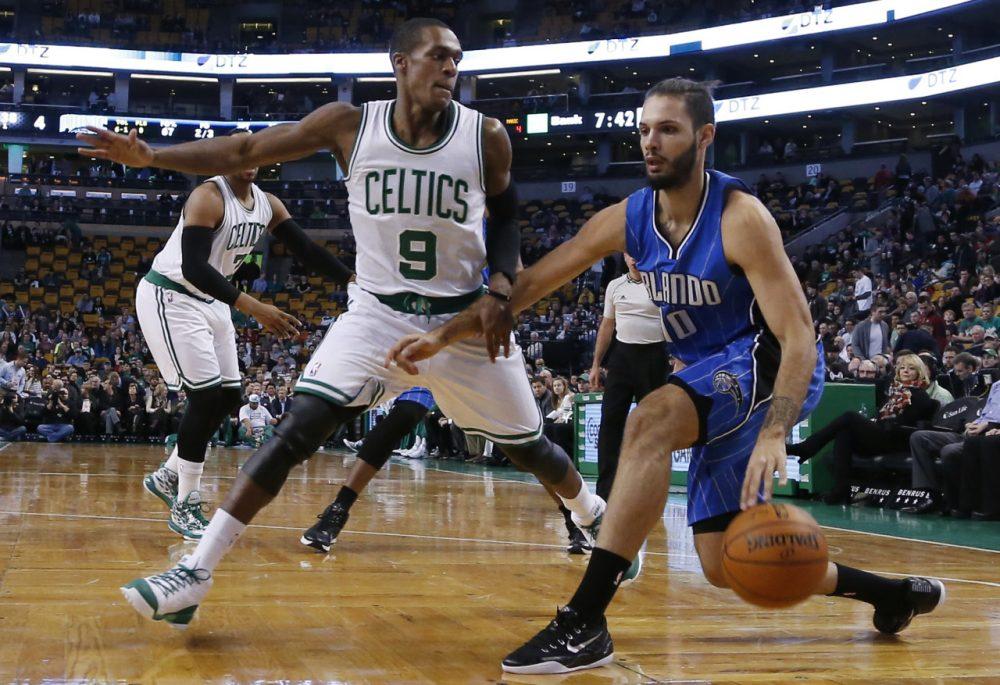 Orlando Magic guard Evan Fournier (10) drives against Boston Celtics guard Rajon Rondo (9) during last night's game in Boston, Wednesday, Dec. 17, 2014. (Elise Amendola/AP)