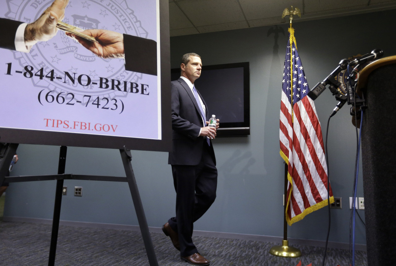 FBI Special Agent in Charge Vincent Lisi, head of the FBI's Boston office, approaches a podium before a news conference Monday. (Steven Senne/AP)