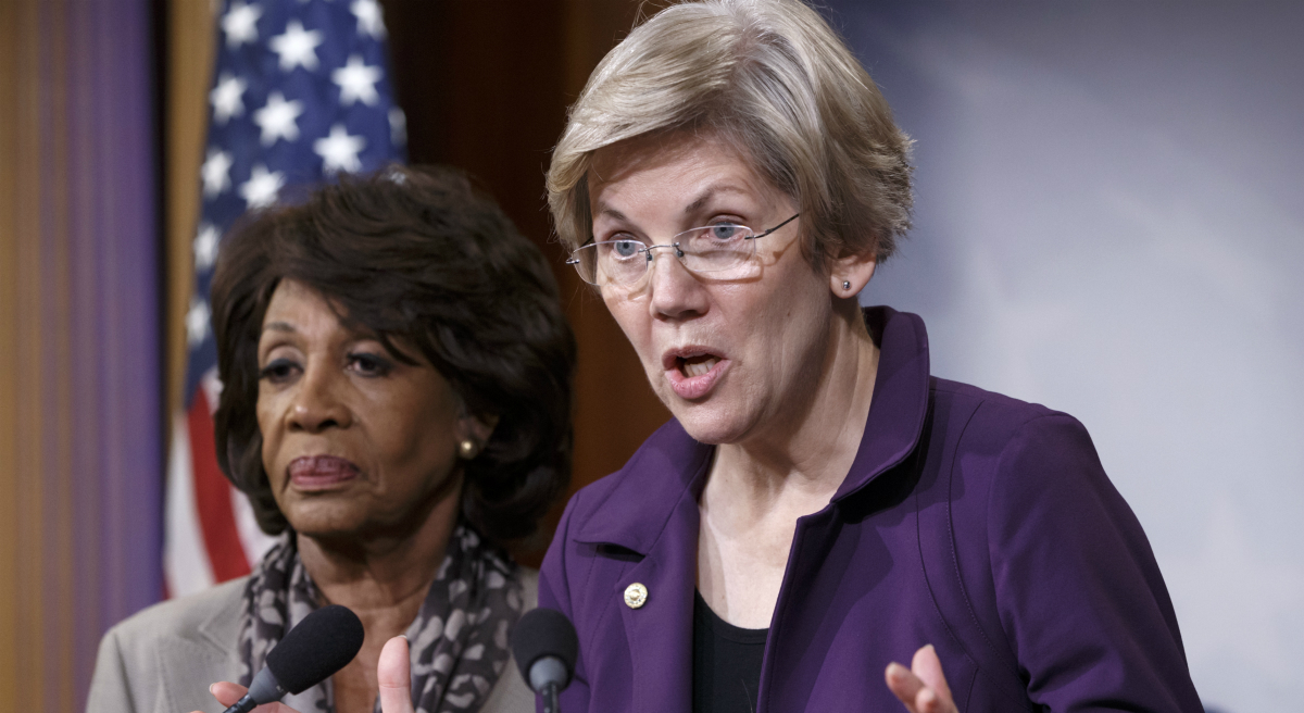 Elizabeth Warren, D-Mass., a member of the Senate Banking Committee, and Rep. Maxine Waters, D-Calif., left, ranking member of the House Financial Services Committee, express their outrage to reporters that a huge, $1.1 trillion spending bill, passed by the Republican-controlled House yesterday, contains changes to the 2010 Dodd-Frank law that regulates complex financial instruments known as derivatives. (J. Scott Applewhite/AP)