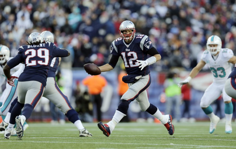 New England Patriots quarterback Tom Brady (12) fakes a handoff to running back LeGarrette Blount (29) in the second half of an NFL football game against the Miami Dolphins Sunday. (Charles Krupa/AP)