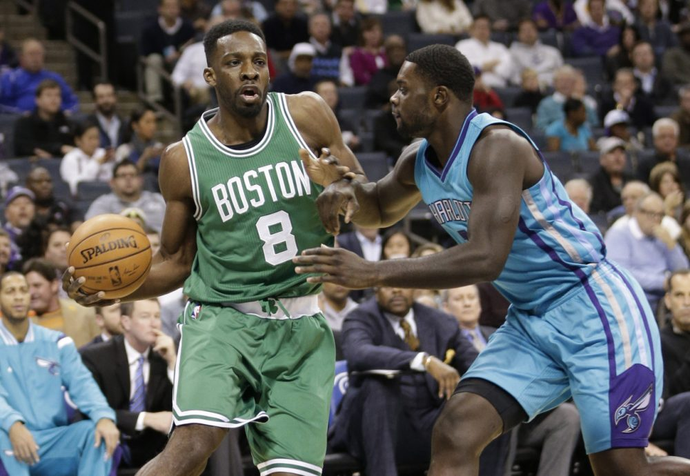 Boston Celtics' Jeff Green (8) drives against Charlotte Hornets' Lance Stephenson (1) during the first half of an NBA basketball game in Charlotte, N.C., Wednesday, Dec. 10, 2014. (Chuck Burton/AP)