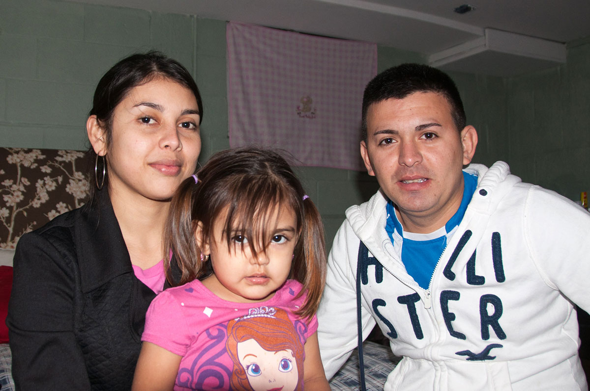 Along with many others from Aqua Caliente, El Salvador, Quenia, left, Salvador and their 6-year-old daughter are now living on Nantucket. (Shannon Dooling/WBUR)