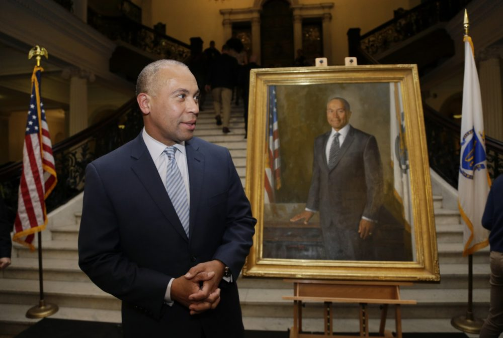 Gov. Deval Patrick stands near his official state portrait following ceremonies Sunday at the State House. (Steven Senne/AP)