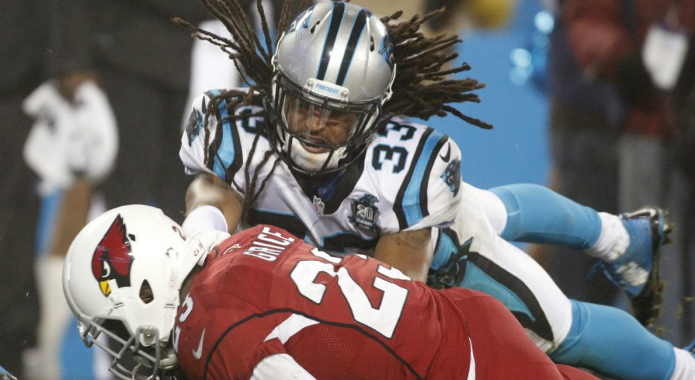 "Garry Emmons: ""The joy of manly contest"" has become ever more bittersweet. In this photo, Arizona Cardinals running back Marion Grice hits the ground as Carolina Panthers free safety Tre Boston defends in the second half of an NFL wild card playoff football game in Charlotte, N.C., Saturday, Jan. 3, 2015. (Bob Leverone/AP)"