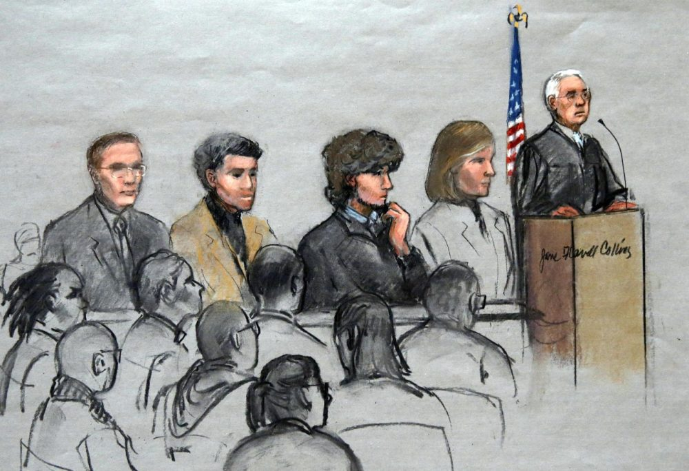 In this courtroom sketch, Boston Marathon bombing suspect Dzhokhar Tsarnaev, third from right, is depicted with his lawyers and U.S. District Judge George O'Toole Jr., right, as O'Toole addresses a pool of potential jurors. (Jane Flavell Collins/AP)