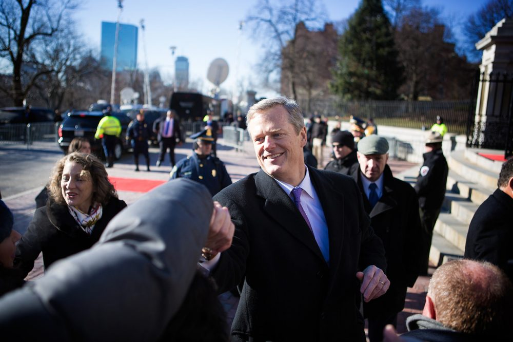 Gov. Charlie Baker greets supporters before walking up the State House steps for his inauguration. (Jesse Costa/WBUR)