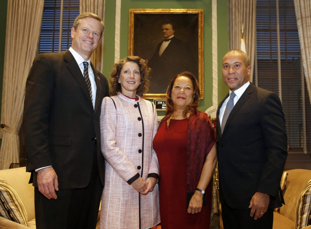 Governor-elect Charlie Baker, left, and his wife, Lauren, pose for a photo with Gov. Deval Patrick and his wife, Diane, in the Governor's Office at the State House, in Boston Wednesday. (Angela Rowlings/The Boston Herald/AP)