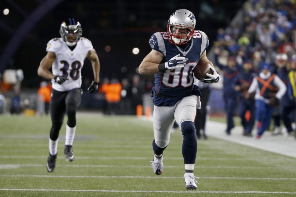 New England Patriots wide receiver Danny Amendola (80) runs with a touchdown pass from Julian Edelman, as he runs from Baltimore Ravens defensive back Rashaan Melvin (38) in the second half of an NFL divisional playoff football game Saturday. (Elise Amendola/AP)