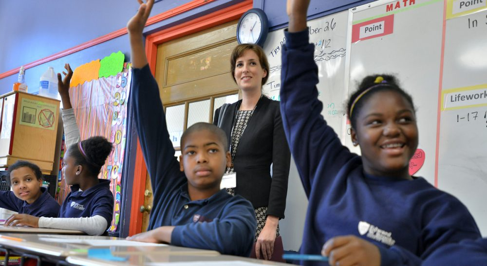 Richard Whitmire: It's time to drop the limits entirely and shift to a system that focuses on building high performing schools, both charter and traditional. Pictured: Students at Boston's Brooke Charter School participate in class. (Josh Reynolds/AP)