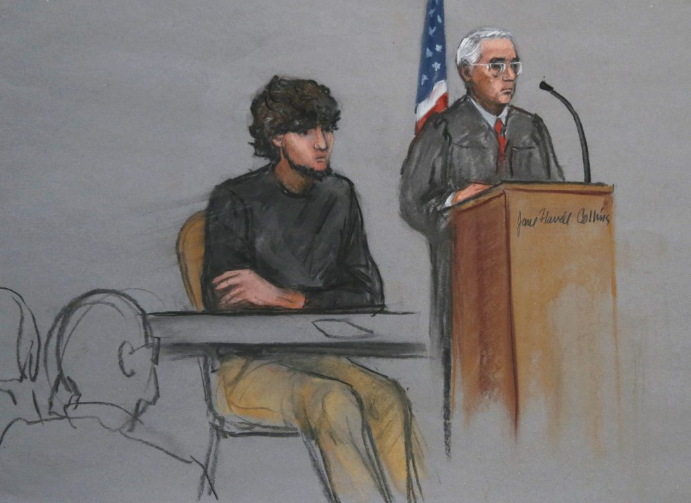 In this courtroom sketch, Boston Marathon bombing suspect Dzhokhar Tsarnaev, left, is depicted beside U.S. District Judge George O'Toole Jr., right, as O'Toole addresses a pool of potential jurors at the federal courthouse in Boston. (Jane Flavell Collins, AP)