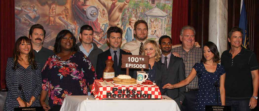 "Cast members of ""Parks And Recreation"" celebrate the show's 100th episode in 2013. (Paul A. Hebert/Invision/AP)"