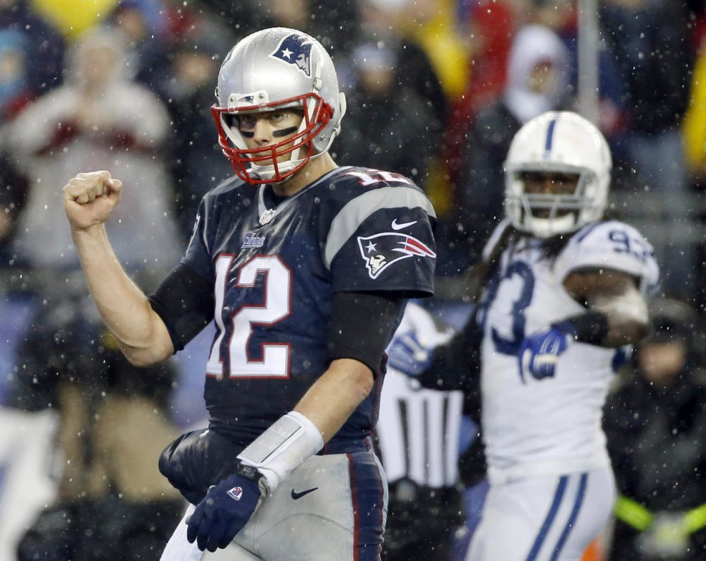 Tom Brady threw for three touchdowns in the Patriots' 45-7 win over the Colts. (Elise Amendola/AP)