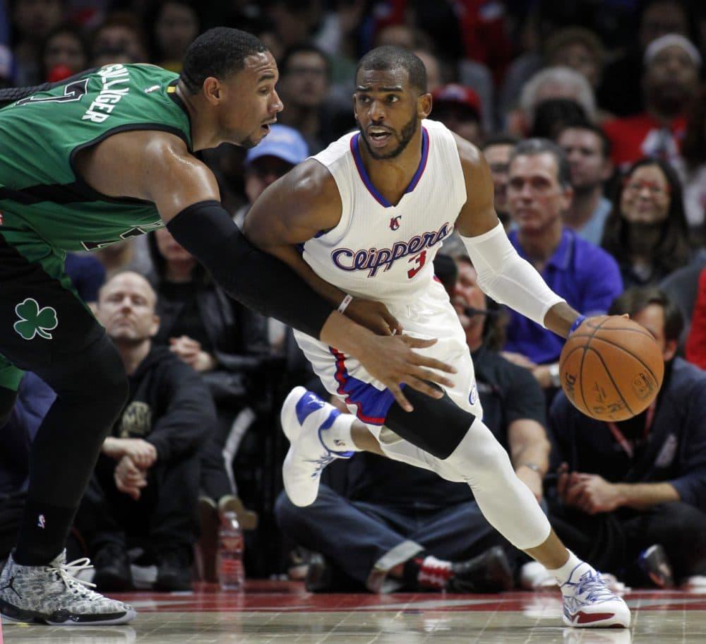Boston Celtics forward Jared Sullinger, left, reaches in as Los Angeles Clippers guard Chris Paul dribbles away from the pressure. (Alex Gallardo/AP)