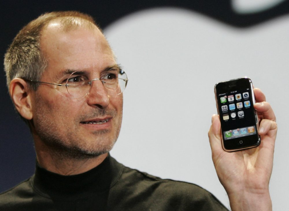 The late Apple CEO Steve Jobs demonstrates the new iPhone during his keynote address at MacWorld Conference in 2011. (Paul Sakuma/AP)