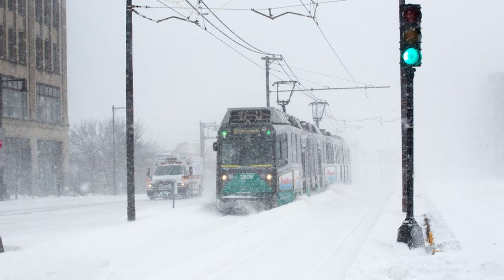 A Green Line train emerges during a recent blizzard on Commonwealth Ave. Delays and closures due to winter weather have brought renewed attention to transportation funding. (Robin Lubbock/WBUR)