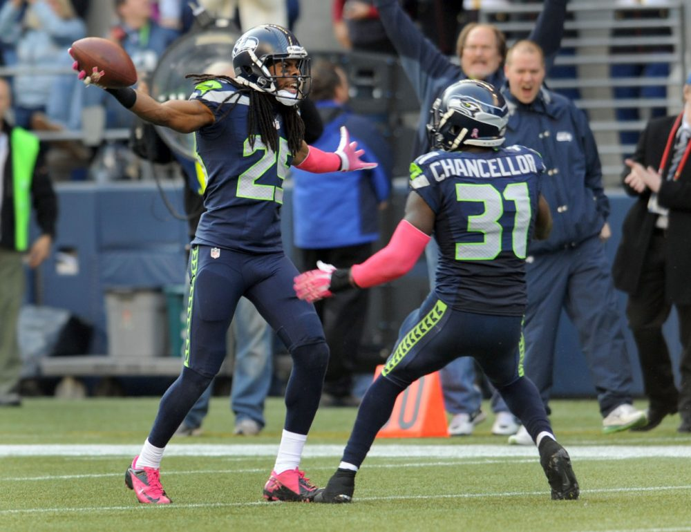 Richard Sherman (left) and Kam Chancellor (right) have helped anchor the Seahawks' secondary this postseason but even they get fined. (Steve Dykes/Getty Images)