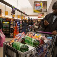 In this 2016 file photo, a customer stocks up on goods at the Stop & Shop at South Bay in Boston. (Robin Lubbock/WBUR)