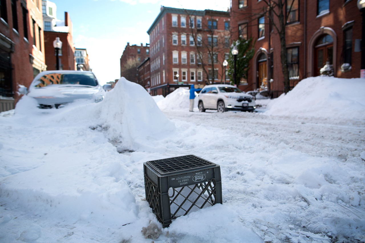 A milk crate was used to save a space on West Concord Street in the South End at the end of January.  (Robin Lubbock/WBUR)