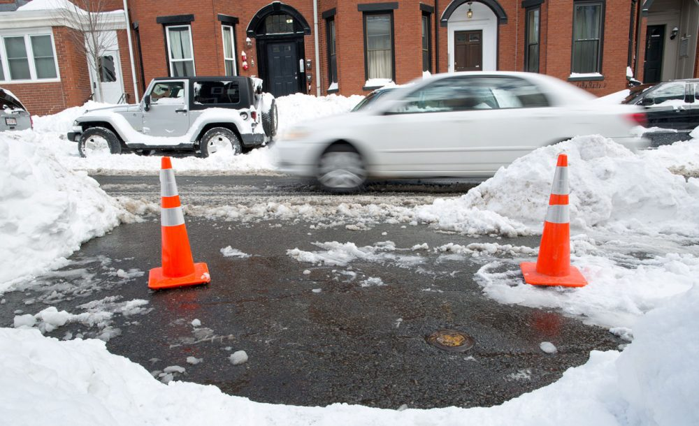 Cones can make a good space saver. These two mark a space on I Street in South Boston.