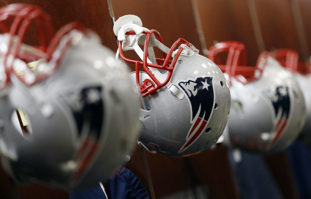New England Patriots helmets are seen in the team locker room at Gillette Stadium last year. (Michael Dwyer/AP)