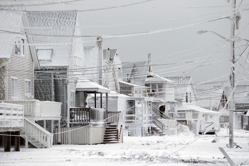 Dexter Newcomb begins cleanup at his house in Scituate, Mass., Wednesday. (Michael Dwyer/AP)