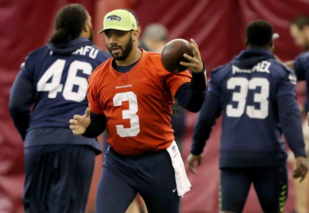 Seattle Seahawks quarterback Russell Wilson runs drills with his team on Friday before Sunday's Super Bowl. (Matt York/AP)