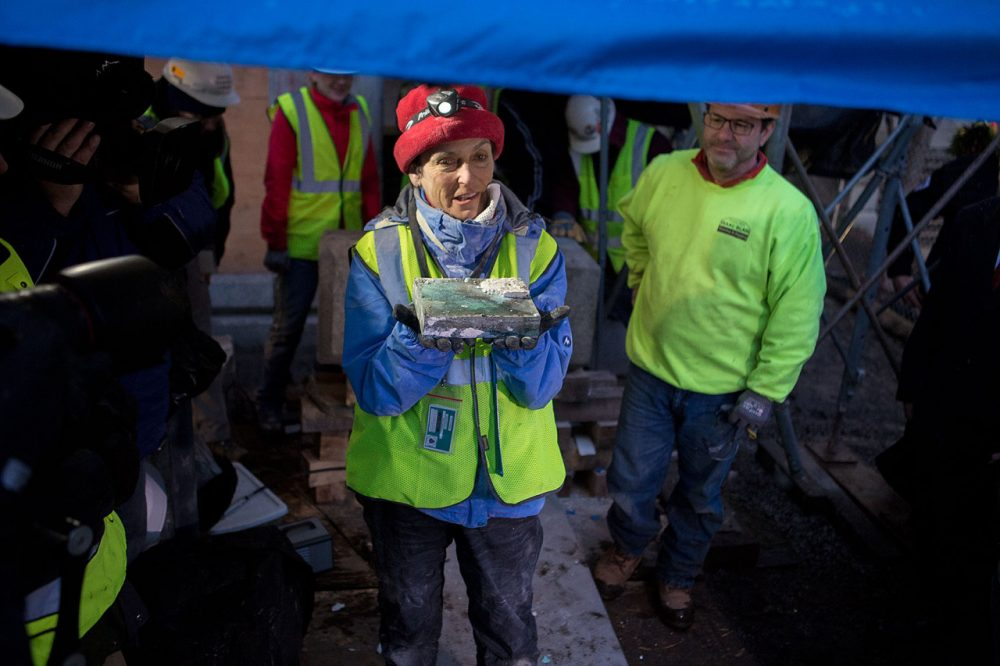 Pamela Hatchfield, head of objects conservation at the MFA, held the time capsule after extracting it from the cornerstone of the State House in December. (Jesse Costa/WBUR)
