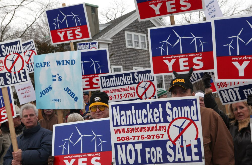 Supporters and opponents of Cape Wind protest outside the Coast Guard Station in Woods Hole in February 2010. (AP)