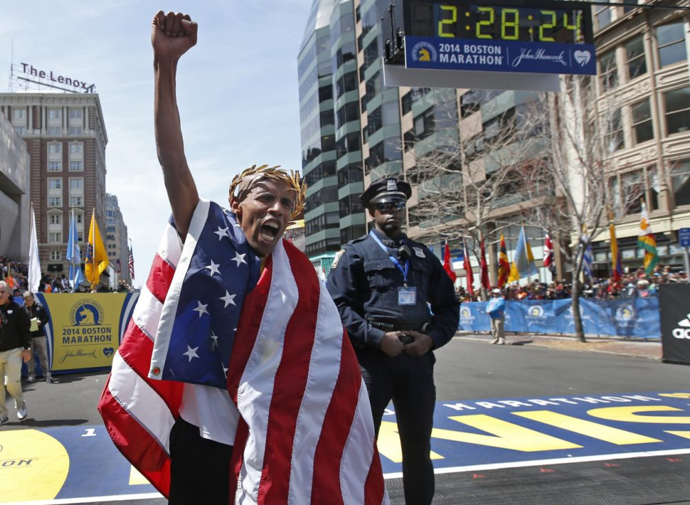 Meb Keflezighi celebrates his 2014 Boston Marathon victory. (Elise Amendola/AP)