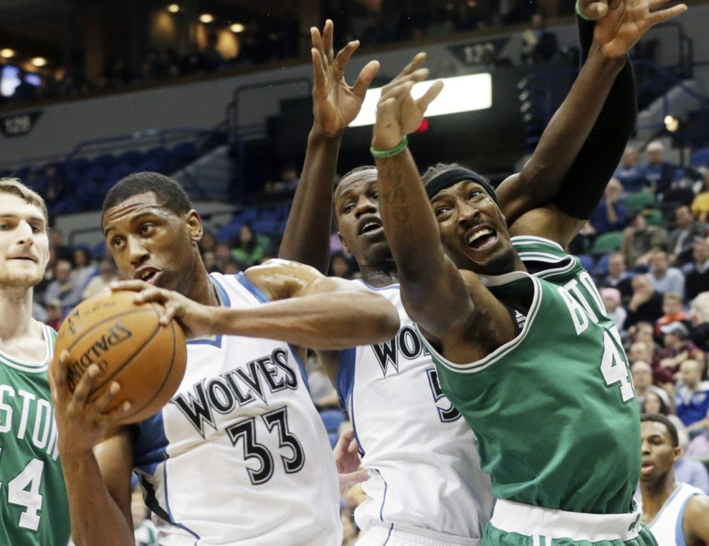 Minnesota Timberwolves' Thaddeus Young, left, beats Boston Celtics' Gerald Wallace, right, to the rebound during Wednesday night's game on Jan. 28, 2015, in Minneapolis. (Jim Mone)