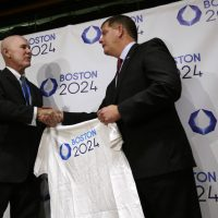 Boston Mayor Marty Walsh, right, is presented with a tee shirt by Ralph Cox, an organizer pursuing an Olympics bid, during an event held to generate public interest in a 2024 Olympics bid for the city of Boston, Monday, Oct. 6, 2014, in Boston. The U.S. Olympic Committee is weighing whether to put in a bid for the 2024 Summer Games. (AP)