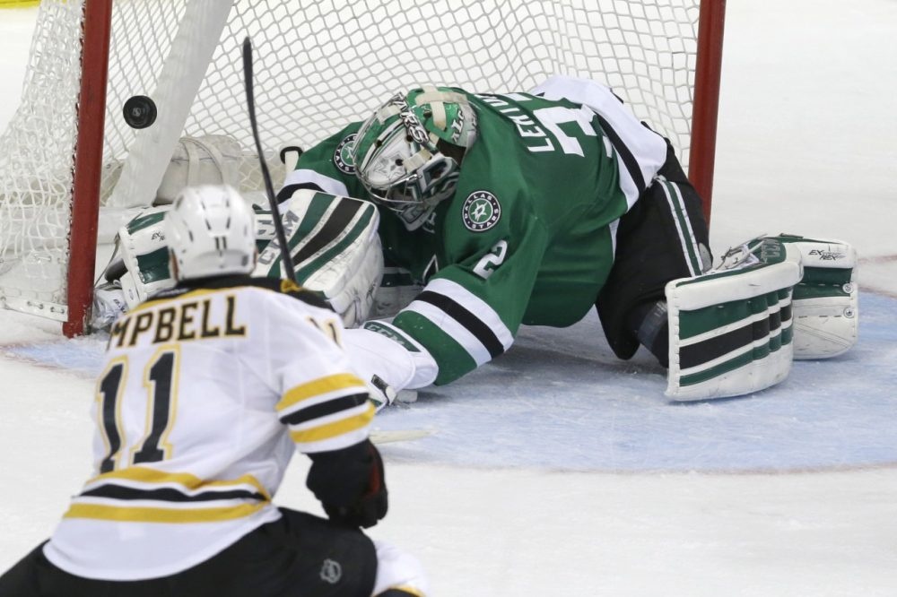 Boston Bruins center Gregory Campbell (11) scores a goal against Dallas Stars goalie Kari Lehtonen (32) during  Tuesday night's game on Jan. 20, 2015, in Dallas. (LM Otero/AP)