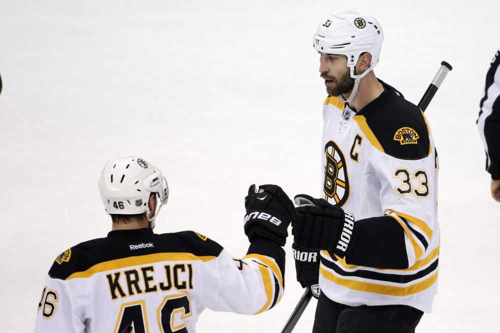 Boston Bruins' Zdeno Chara (33) celebrates his goal with David Krejci (46) during the first period against the Pittsburgh Penguins in Pittsburgh on Wednesday, Jan. 7, 2015. (Gene J. Puskar/AP)