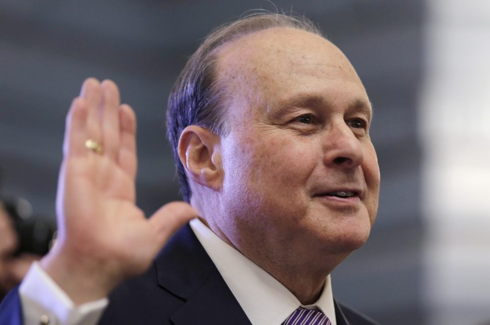 Mass. Senate President Stanley Rosenberg raises his hand as he is sworn into office at the State House Wednesday. (Charles Krupa)