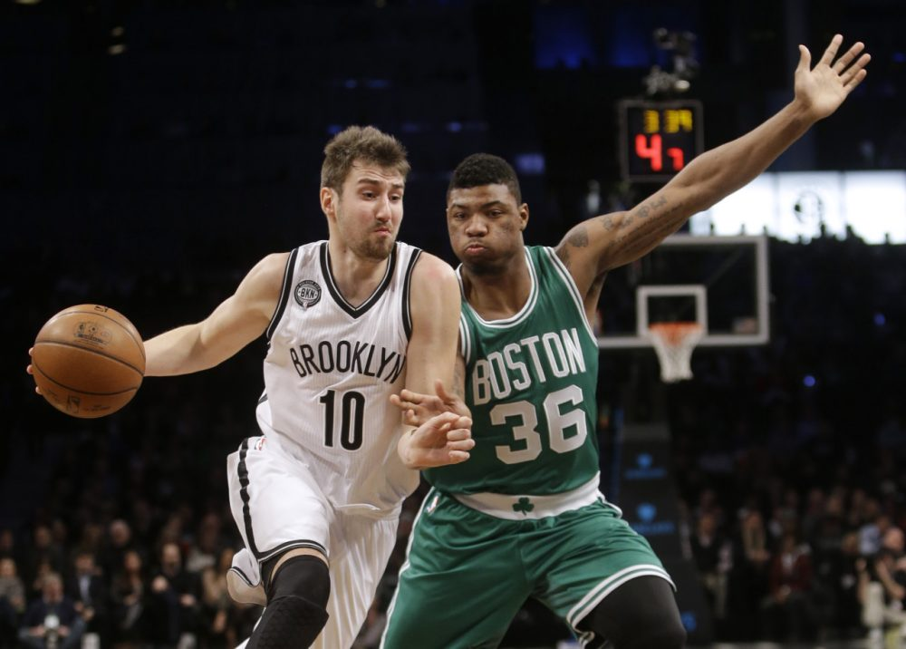 Brooklyn Nets' Sergey Karasev (10), of Russia, drives past Boston Celtics' Marcus Smart (36) during Wednesday's game on, Jan. 7, 2015, in New York. (Frank Franklin II/AP)