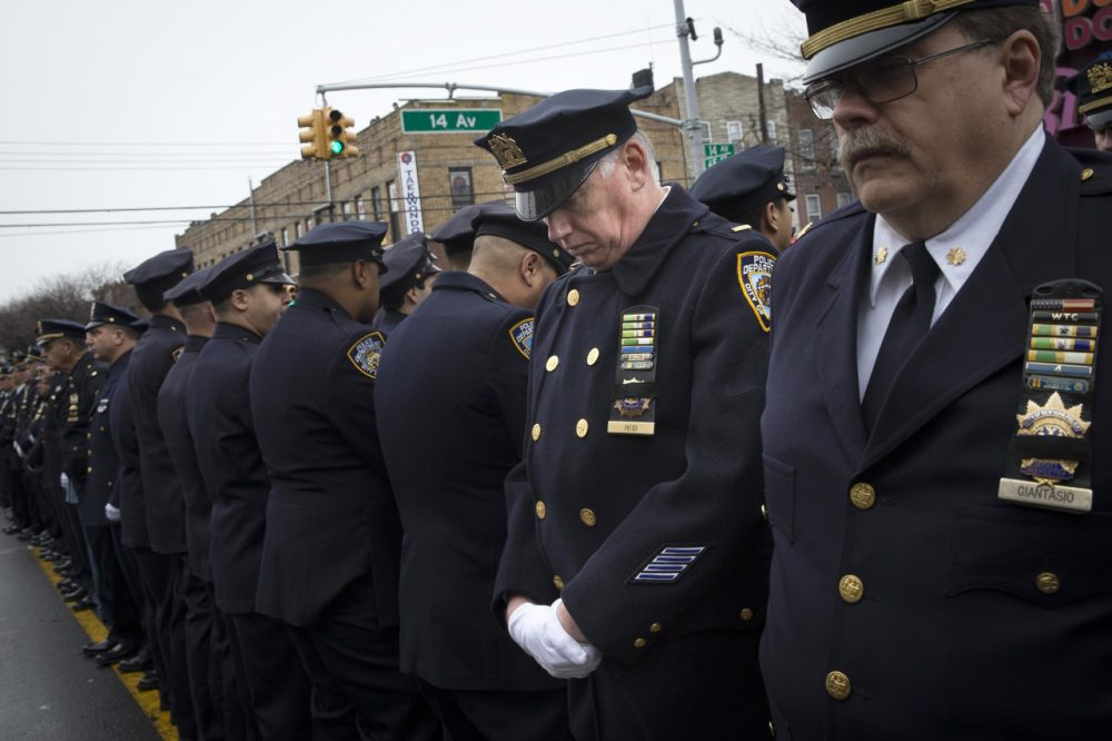 Some police officers turn their backs as Mayor Bill de Blasio speaks during the funeral of NYPD Officer Wenjian Liu. (John Minchillo/AP)