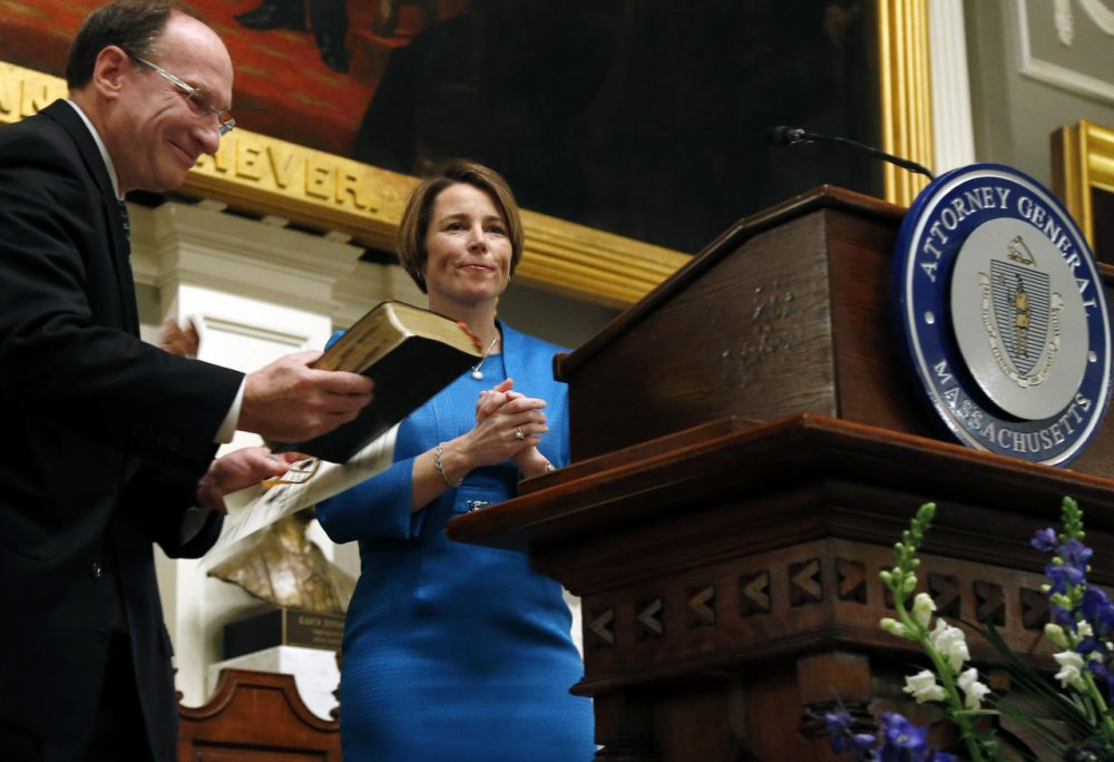 Maura Healey is sworn in as Massachusetts' 55th attorney general during a ceremony at Faneuil Hall in Boston Wednesday. Massachusetts Supreme Judicial Court Chief Justice Ralph Gants, left, administered the oath (Elise Amendola/AP)