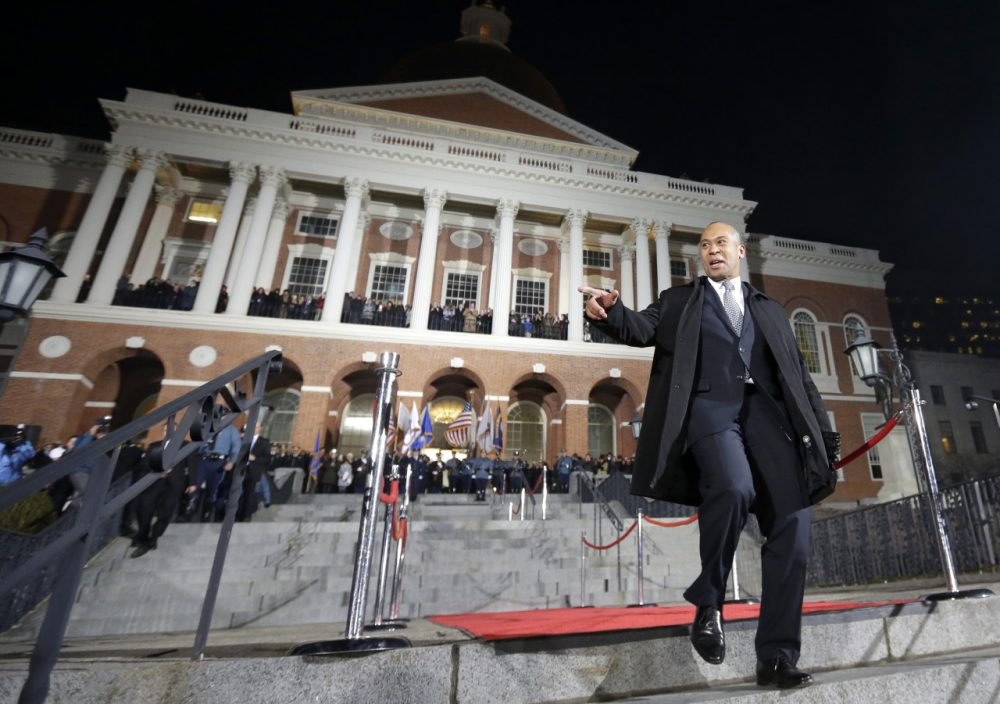 "Signifying his final day in office, Gov. Deval Patrick completes the traditional ""lone walk"" down the stairs in front of the State House Wednesday, Jan. 7, 2015. (Steven Senne/AP)"