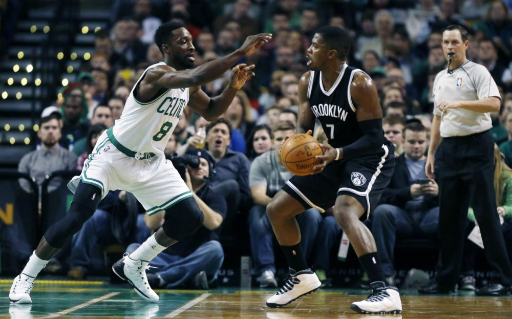 Boston Celtics' Jeff Green (8) defends against Brooklyn Nets' Joe Johnson (7)  in Boston on Friday, Dec. 26, 2014. (Michael Dwyer/AP)