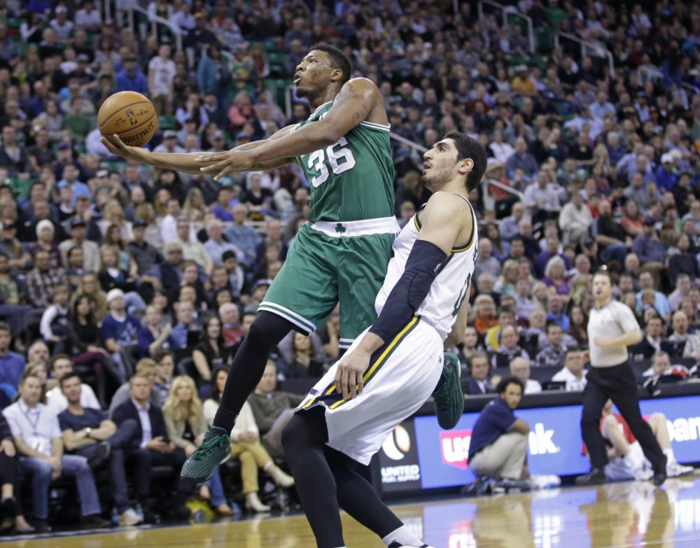 Boston Celtics guard Marcus Smart (36) lays the ball up as Utah Jazz center Enes Kanter, right, defends during Monday night's game on Jan. 26, 2015, in Salt Lake City.  (Rick Bowmer/AP)