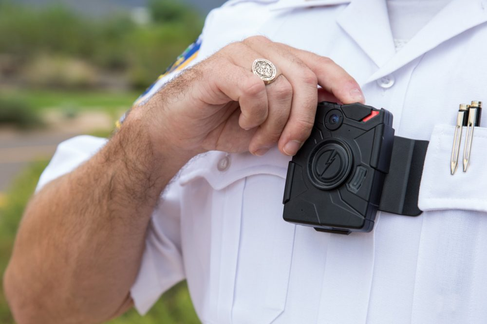 A lieutenant in the Riverdale Park Police Department in Maryland demonstrates how to use a body camera made by TASER. (TASER)