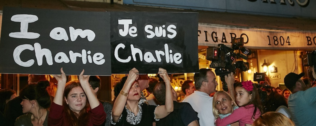 """Members of the French-American community of Los Angeles hold signs reading """"I'm Charlie,"""" """"Je Suis Charlie,"""" at a gathering  outside of the French restaurant """"Figaro"""" in Los Angeles. (Damian Dovarganes/AP)"""