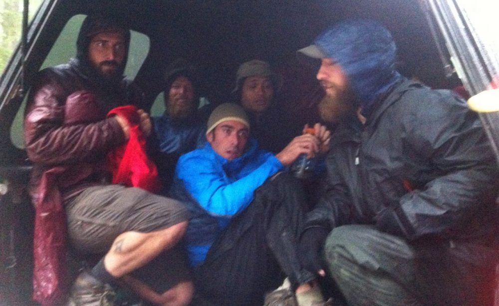 Hikers crowd into the back of a pickup truck to escape the rain. (Courtesy Brittany Goodson)