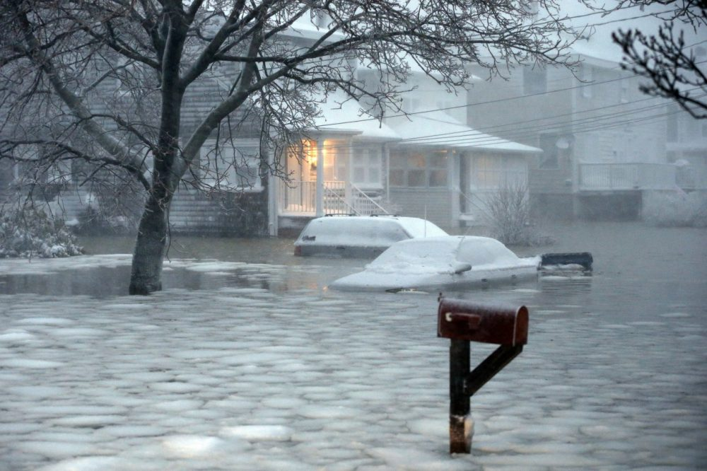 Water flooded a street on the coast in Scituate as a blizzard hit the area on Jan. 27, 2015. (Michael Dwyer/AP)