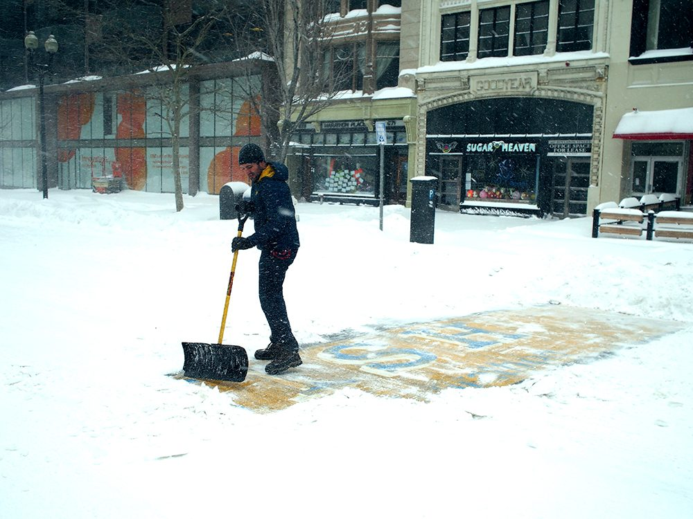 Chris Laudani shovels the Boston Marathon finish line during a major snow storm in Boston. Laudani was the focus of a massive internet search to determine who it was that shoveled the finish line. (Adam Reynolds)